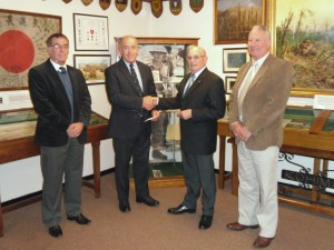 Worshipful Master presents a cheque to Curator Bob Cook